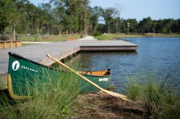 Canoe_in_grass_at_boardwalk.jpg